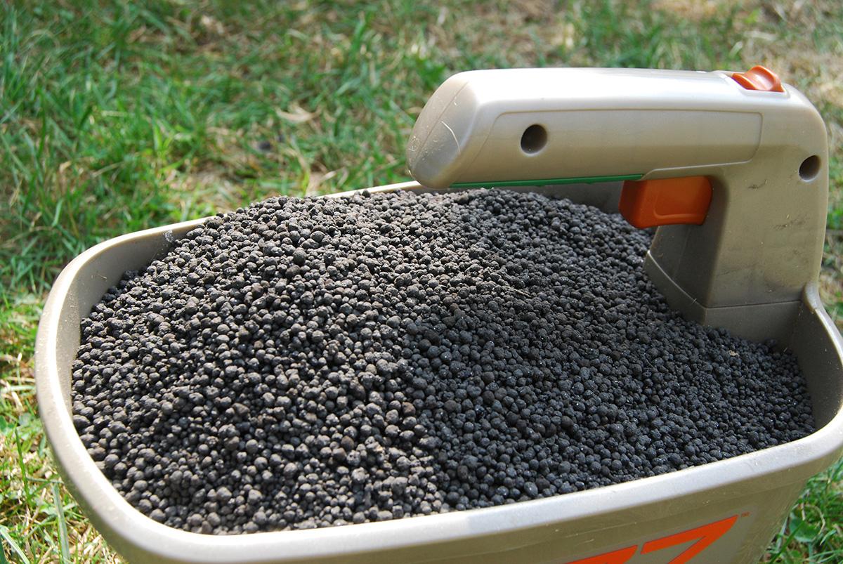 Fertilizer in handheld spreader