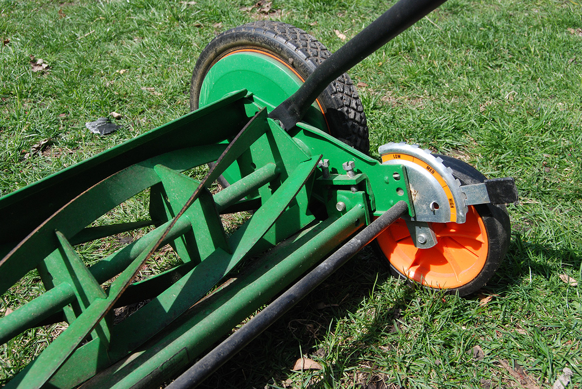 Non-electric push mower on green lawn