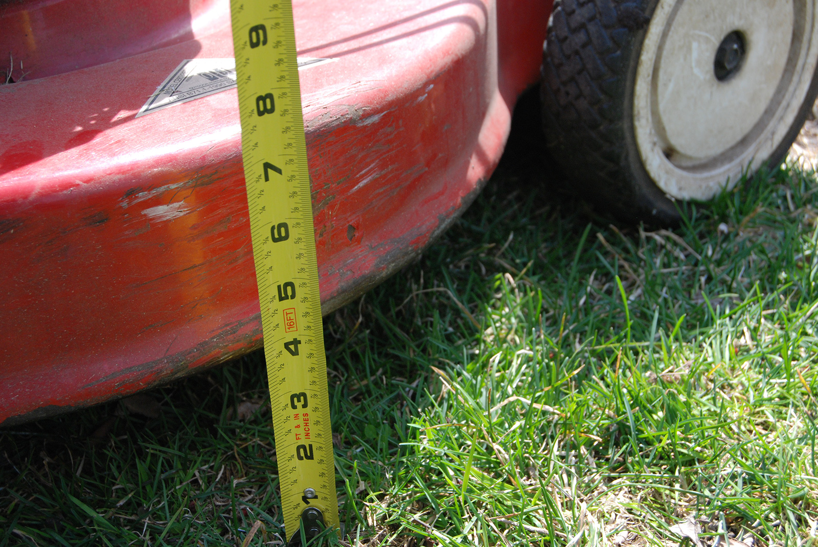 Mower deck height three and half inches with measuring tape